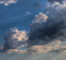 Cumulus clouds with rays of sun by Kristian Tuhkanen