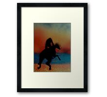 Riding on the beach at sunset Framed Print