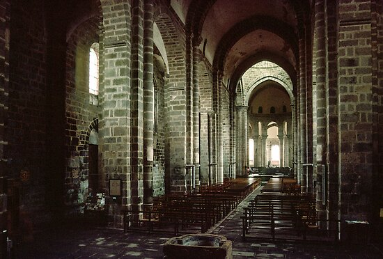 Nave with font at front altar in distance Le Dorat Church 198402260004  by Fred Mitchell