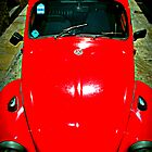 Looking down onto a red VW Beetle by blackpixi