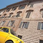 Bright yellow classic Fiat 500 in Italian street. by brians101