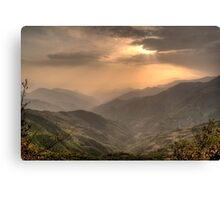 Green mountains over red sky Canvas Print
