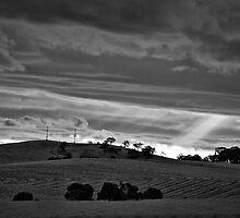 Sunburst through the cloud by Lee Hopkins