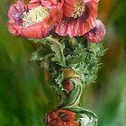 Poppies In Poppy Vase by Carol  Cavalaris