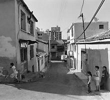 Children Playing on the Street in Izmir Turkey by Ilker Goksen