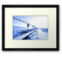 cold snow covered path on cliff fenced walk Framed Print