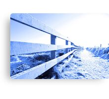 cold snow covered path on cliff fenced walk Canvas Print