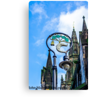 lamppost with symbols of Glasgows coat of arms. Canvas Print