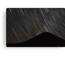 The stars wheel over Mt. Doom Canvas Print