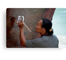 Man painting his Thai taxi boat Canvas Print