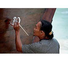 Man painting his Thai taxi boat Photographic Print