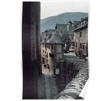 Tourists in church yard Conques 19840228 0032 Poster
