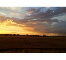 The sun sets over the fields Photographic Print