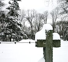 cross in snow by robingailwood
