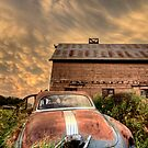 Storm Clouds Saskatchewan antique car and barn by pictureguy