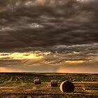 Storm Clouds Saskatchewan hay bales in Canada by pictureguy