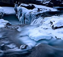 Elbow Falls Bragg Creek Alberta Canada in Winter by pictureguy