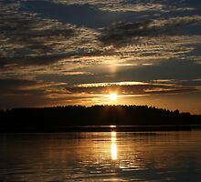 Sunset over lake by llvllagic