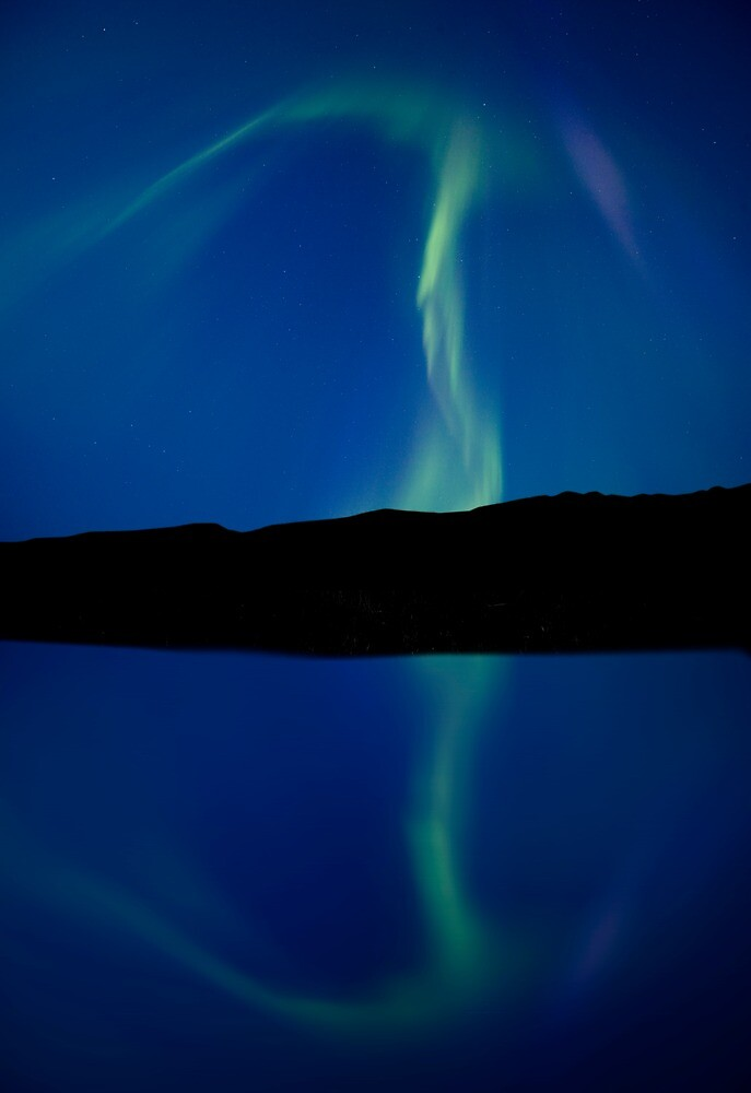 Northern Lights and reflection lake Saskatchewan Canada by pictureguy