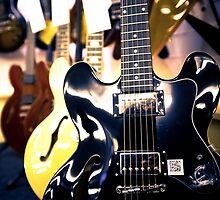 Shiny six strings by Greg  Walker