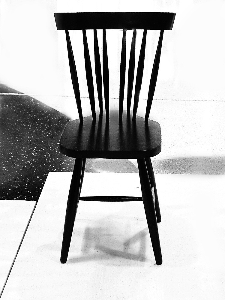 Black chair by Paul Pasco