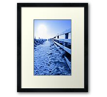 snow covered path on cliff fenced walk Framed Print