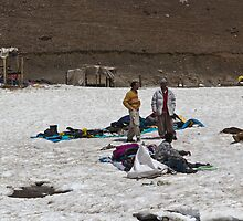 Locals with a pile of ice boots and snow jackets by ashishagarwal74
