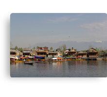 Wooden boats, shikaras and houseboats in the Dal Lake in Srinagar Canvas Print