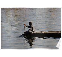 Splashing in the water caused due to Kashmiri man rowing a small wooden boat Poster