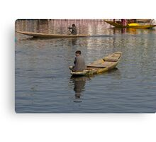 Kashmiri men rowing many small wooden boats Canvas Print
