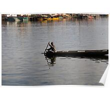 Kashmiri man rowing a small wooden boat Poster
