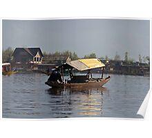Kashmiri man rowing a shikara in the waters of the Dal Lake in Srinagar Poster