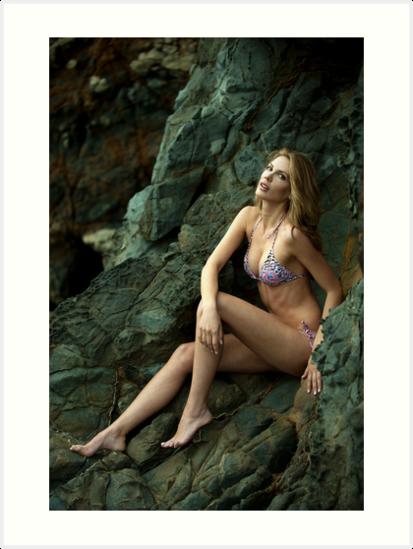 Bikini model posing in front of rocks in Palos Verdes, CA by Anton Oparin