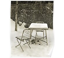 Vintage metal chairs covered with snow Poster