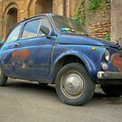 Old and rusted Fiat 500 in Rome by wildrain
