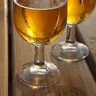 Beer Glasses on Wooden Table by jojobob