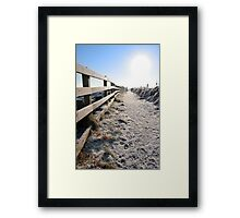 frozen snow covered path on cliff fenced walk Framed Print