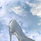 glass high heel slipper on rocky surface by morrbyte