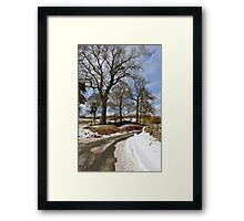 Winter still clings on Framed Print