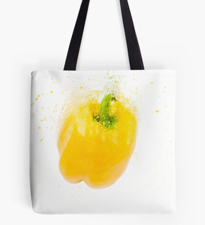 Exploding Yellow Bell pepper (Capsicum annuum) on white background Tote Bag