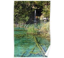 Small waterfall and an emerald colored lake Poster