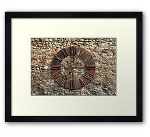 Ancient Clock Face on wall Background Framed Print