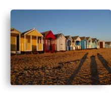 Beach Huts At Sunset Canvas Print