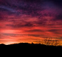 Sunrise with colorful and dramatic sky clouds by Mario Cehulic