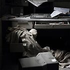 cluttered desk by KreddibleTrout