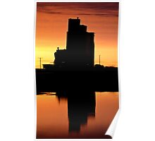 Eyebrow gain elevator reflected off water after sunset Poster