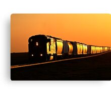 Setting sun reflecting off train and track Canvas Print