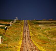 Storm clouds seen along a Saskatchewan country road by pictureguy