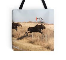 Young moose leaping over barbed wire fence Tote Bag