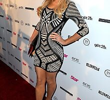 Primodels Complaints-Paris Hilton shows off in a geometric print dress by primodels